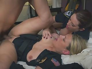 A nasty brunette cop sucks black dude's cock then stud fucks her blonde partner