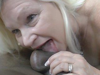 Blonde granny gives head and rides black cock