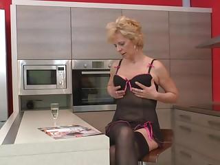 This blonde mature slut loves to masturbate in her kitchen