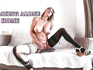 Blonde in stockings with big natural tits masturbates