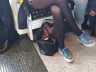 Long pantyhose legs on London underground