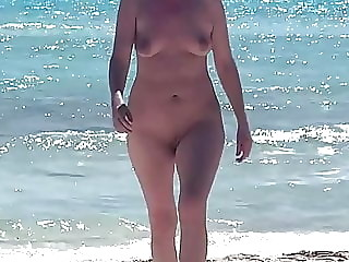 Wife naked on the beach