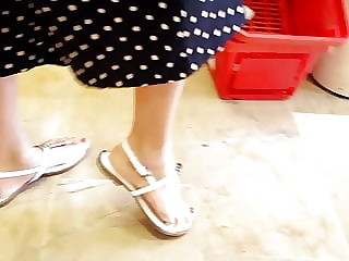 candid sexy long feets, red toes in sandals
