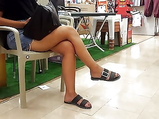 Short skirt, sexy crossed legs, dangling feets