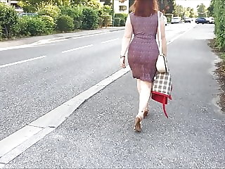 walking down the road in sexy dress